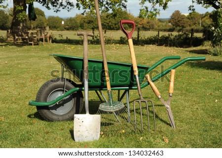 wheelbarrow and tools - stock photo