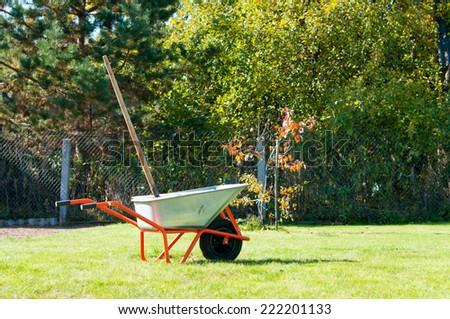 Wheelbarrow in garden - stock photo