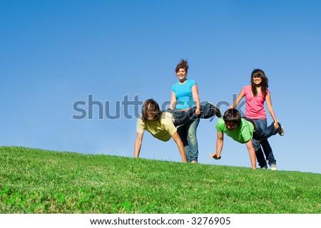 wheelbarrow race - stock photo