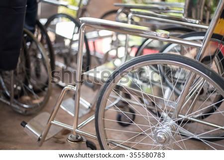 wheelchair in hospital - stock photo