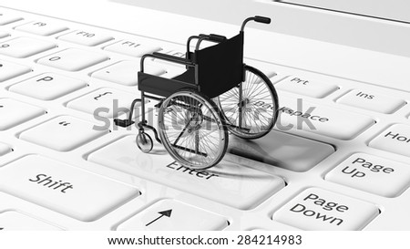 Wheelchair on black laptops keyboard, conceptual - stock photo