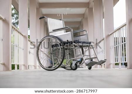 wheelchair on the Walk - stock photo