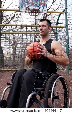 wheelchair users in sports, basketball,  strong man - stock photo