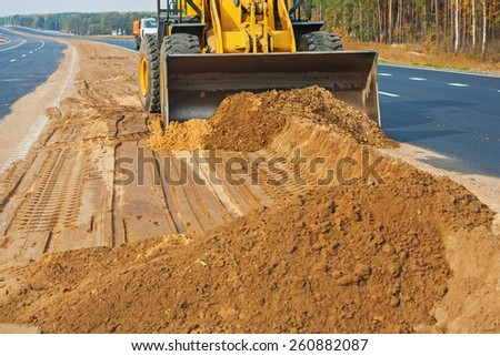 wheelloader working with sand  - stock photo