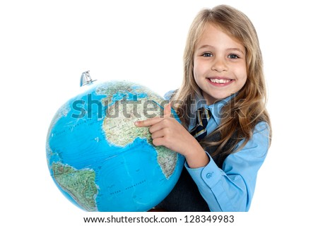 Where are you located on the globe? Smiling cute schoolgirl. - stock photo