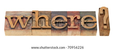 where question in vintage wood letterpress printing blocks, stained by color inks - stock photo