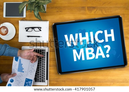 WHICH MBA? Businessman working at office desk and using computer and objects, coffee, top view, - stock photo