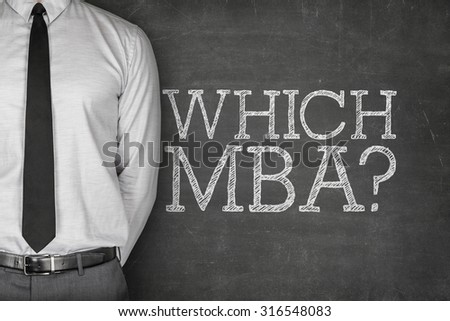 Which MBA on blackboard with businessman in a suit on side - stock photo