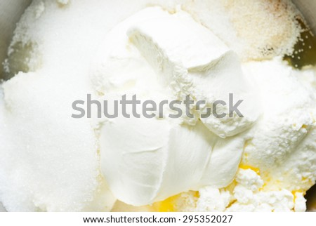 whipped cream topped dessert ingredients in metal mixing bowl - stock photo