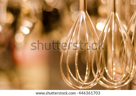 whisk mixer in soft focus - stock photo