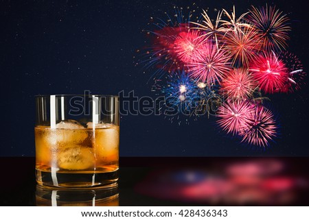 Whiskey and celebration colorful fireworks. Amazing fireworks over night sky. Beautiful fireworks. 4 of July.  4th of July. Independence Day. New Year. Holidays salute of various colors on night sky. - stock photo