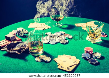Whiskey, cigar and cards in vintage gambling table - stock photo
