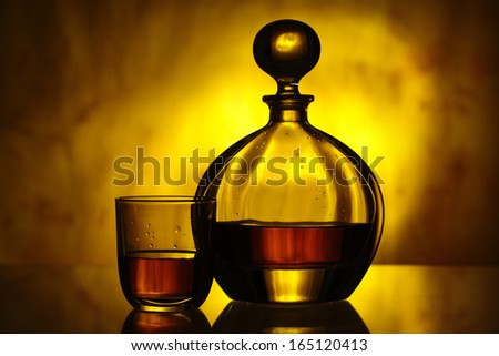 whiskey decanter and glass - stock photo