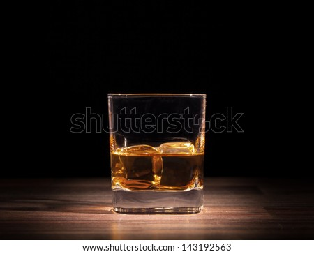 Whiskey drink on wooden table - stock photo
