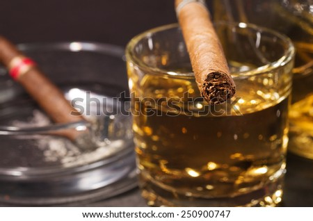 Whiskey drink with cigar  - stock photo