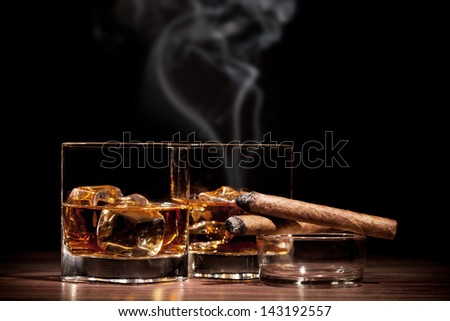 Whiskey drinks with cigars on wooden table - stock photo
