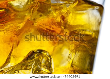 Whiskey glass with ice - stock photo