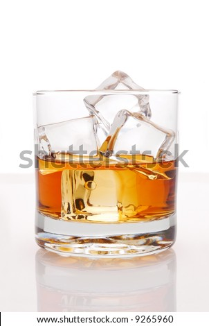 Whiskey in Glass of Ice with with reflection isolated over white - stock photo