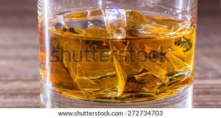 whiskey in glass with ice cubes. symbolic photo for cocktails and drinks - stock photo