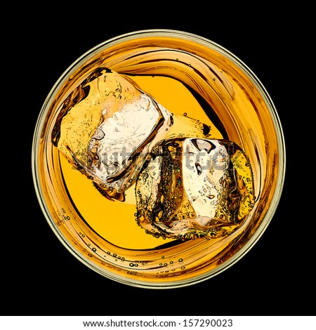 Whiskey in rocks glass with ice cubes on black background - stock photo