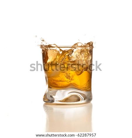whiskey on glass on white background - stock photo