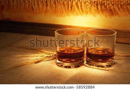 whiskey on sacking with wheat straws - stock photo