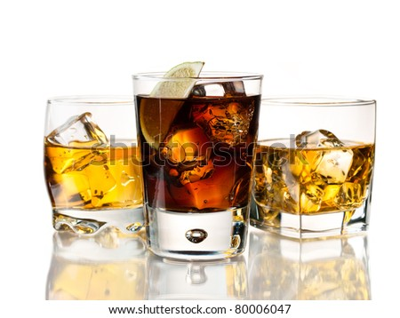 Whiskey on the rocks and cuba libre - stock photo
