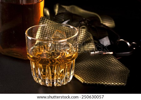 Whiskey on the rocks on a hard day's night - stock photo