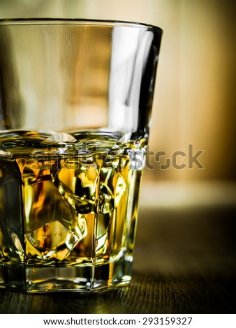 Whiskey on the rocks on a wooden background - stock photo