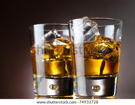 whiskey on the rocks, vibrant colors - stock photo