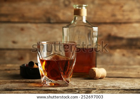 Whiskey on wooden background - stock photo