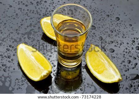 Whiskey shot with lemon - stock photo