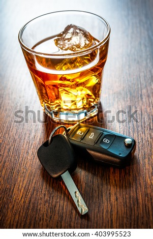 Whiskey with car keys concept for drinking and driving - stock photo