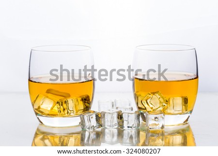 Whiskey with ice cubes in glass - stock photo