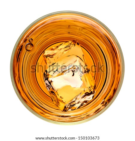 Whiskey with ice cubes in rocks glass from top on white background - stock photo