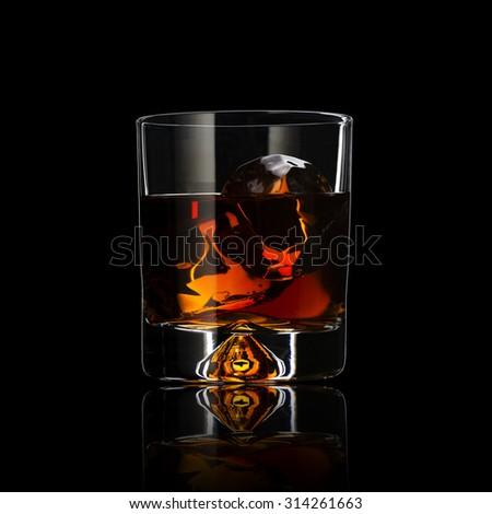 Whiskey With Ice Cubes On Black Background - stock photo