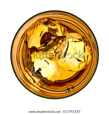 Whiskey with ice in glass from top on white background - stock photo