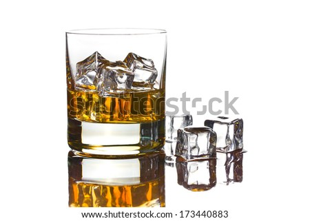 whiskey with ice in glass on white background - stock photo
