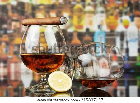 Whisky, cigar and lemon slice on table - stock photo