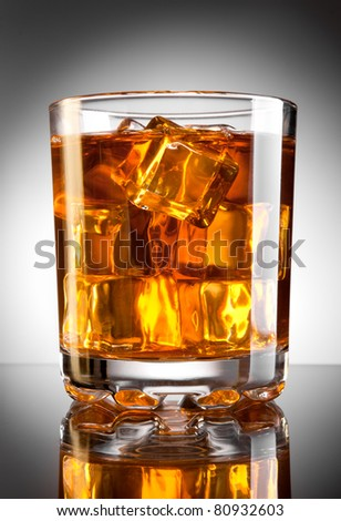 Whisky glass with ice cubes - stock photo