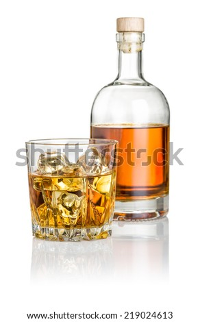 Whisky on the rocks with a bottle - stock photo