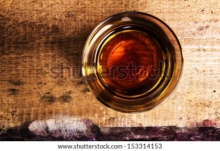 whisky Scotch  on wooden background with copyspace. An old and vintage countertop and glass of hard liquor. Top view. - stock photo