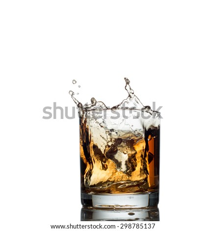whisky splash isolated on a white background.  - stock photo