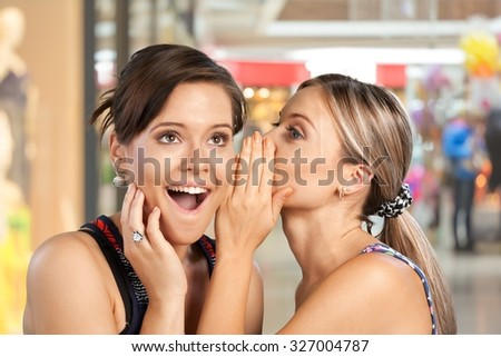 Whispering. - stock photo