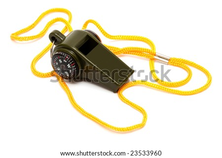 Whistle with a compass on a yellow cord - stock photo