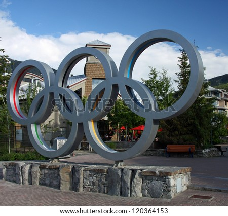 WHISTLER VILLAGE - JUL 12: Olympic rings in Whistler Village, site of the 2010 Winter Olympics and Paralymics. Taken July 12, 2011 in Whistler Village, British Columbia, Canada. - stock photo