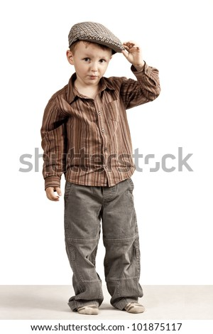 Whistles at you all, but I say hello. Regards, rogue.A little boy greets holding cap in his hand. - stock photo