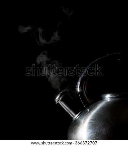 whistling kettle, boiling kettle, steam, isolated on a black background - stock photo