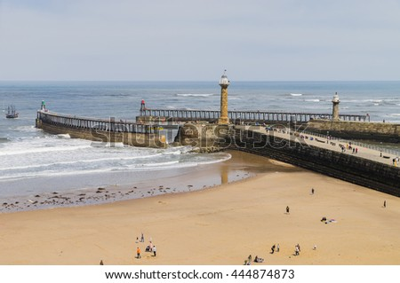 Whitby, North Yorkshire, UK;  East and West Piers of the Harbour with their Lighthouses and Beacons - stock photo