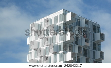 White abstract background of a modern apartment building with balconies - stock photo